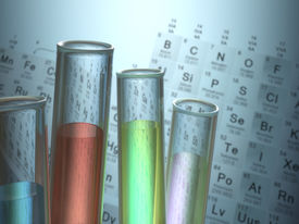 stock photo of periodic table elements  - Test tubes with chemical elements inside and periodic table on background - JPG