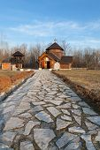 foto of velika  - A stone path to an orthodox church in Velika Plana etno village in Serbia - JPG