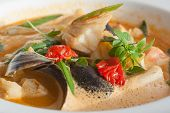 Seafood soup with tomatoes and oregano