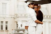 Young Couple With Umbrella.