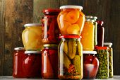 picture of pickled vegetables  - Jars with pickled vegetables fruity compotes and jams in cellar - JPG