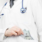 Doctor Putting Money Into His Pocket
