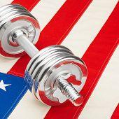 Metal Dumbbells Over Us Flag As Symbol Of Healthy Nation - Studio Shot