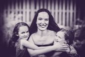 Daughters Hugging Their Mother - Black And White