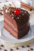 Piece Of Chocolate Cake With Cherries On A Plate. Vertical