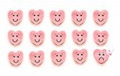 pic of love bite  - Three rows of pink heart shaped candy have happy faces - JPG