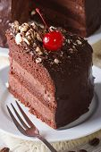 Cut A Piece Of Dark Chocolate Cake With Cherry Vertical