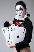 picture of harlequin  - Woman in disguise harlequin in the studio - JPG