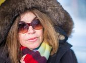 foto of close-up middle-aged woman  - Beautiful middle age woman close up portrait wearing a thick coat in the Canadian Winter - JPG