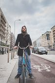 Young Handsome Bearded Man Posing With His Bicyle