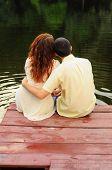 Lovers Sitting On The Pierce