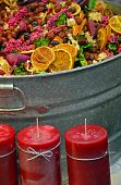 Colorful Potpourri And Red Candles