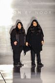 NEW YORK - FEBRUARY 14: A designers Shaikha Noor Al Khalifa and Shaikha Haya Al Khalifa walks the runway at the Noon by Noor during Mercedes-Benz Fashion Week in New York on February 14, 2015.