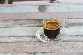 Coffee mug on old wooden table