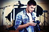 pic of studio  - Handsome photographer with camera in photo studio - JPG