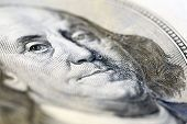 Portrait of Benjamin Franklin on hundred dollar banknote, macro view