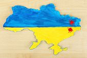 Map of Ukraine with blood - concept of war in the country