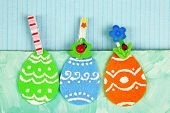 Felt Easter eggs on craft colorful background