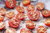Close-up Of Baking Tray With Seasoned Tomatoes