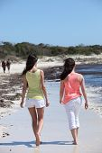 Rear View Of Women Walking At The Beach
