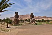 stock photo of pharaohs  - The Colossi of Memnon two massive stone statues of Pharaoh Amenhotep III in Luxor Egypt - JPG