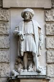 VIENNA, AUSTRIA - OCTOBER 10: Hugo Haerdtl: Merchant, on the facade of the Neuen Burg on Heldenplatz in Vienna, Austria on October 10, 2014.