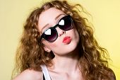 Pretty Young Beautiful Girl In Sunglasses Makes Lips Kiss