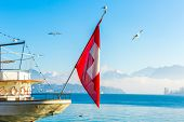 Boat with Swiss Flag on Lucerne, Switzerland.