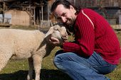 Attractive Man Hugging A Cute Lamb
