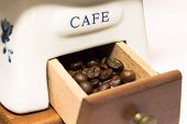 coffee beans in  box from  old hand grinder