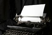 Old Type Writer With A Blank Sheet Of Paper