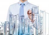 Businessman Drawing Skyscraper