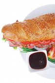 french sandwich : fresh white baguette with smoked sausage isolated over white