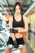Fitness woman working out with dumbbell