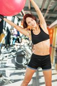 Beautiful woman exercising with ball