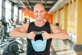 Man lifting kettlebell workout exercise at gym
