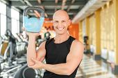Male athlete working out with kettlebell