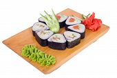 Japanese cuisine serving, roll sushi on wooden board isolated white background