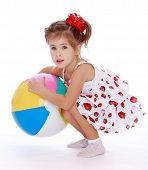 pretty little girl with big inflatable ball.