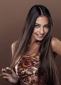 cute happy young indian real woman in studio close up smiling, f