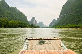 stock photo of raft  - Bamboo rafting li river from guilin to yangshuo china - JPG