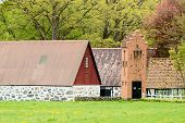 stock photo of barn house  - Old telegraph or telephone switch house beside farm houses and barns - JPG