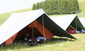 picture of boy scouts  - big tent of boy scout camp with backpacks and sleeping bags spread out - JPG