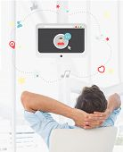 stock photo of video chat  - Rear view of a casual man resting with hands behind head in office against video chat graphic - JPG