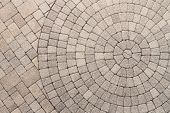 stock photo of pattern  - Paver bricks arranged in a circular pattern of concentric geometric circles - JPG