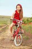 pic of preteen  - Preteen girl on bicycle in spring field - JPG