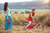 picture of preteens  - Preteen girl on bicycle with mother in spring field - JPG