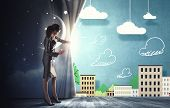 picture of curtains stage  - Young businesswoman opening stage curtain to another reality - JPG