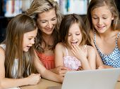 foto of mums  - Little girls and their mum with a laptop in library - JPG