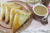 pic of baklava  - Turkish baklava and coffee on a plate with sliced lemons - JPG